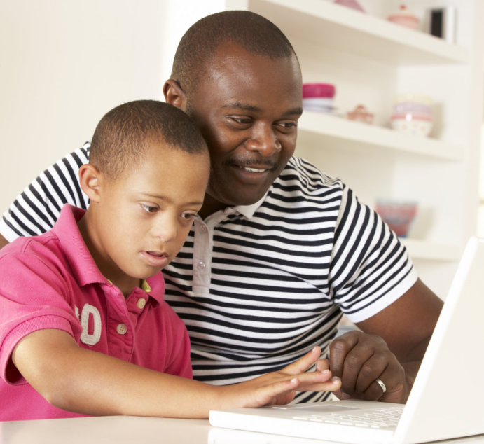 father and son using a laptop