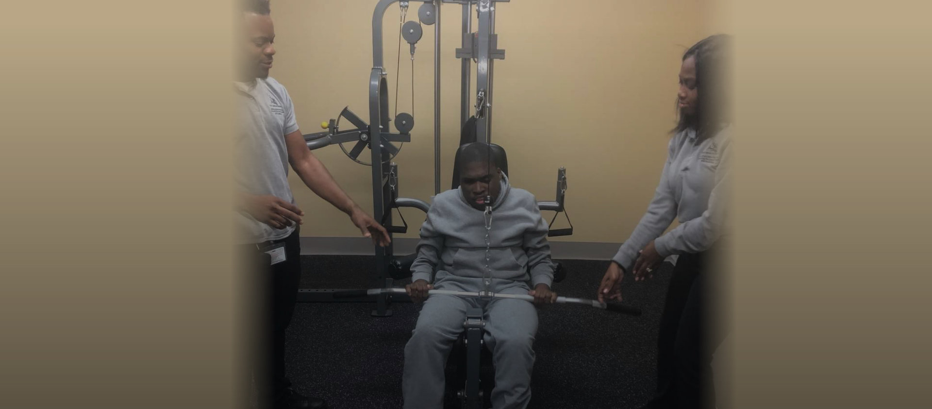 people helping a man doing his exercise