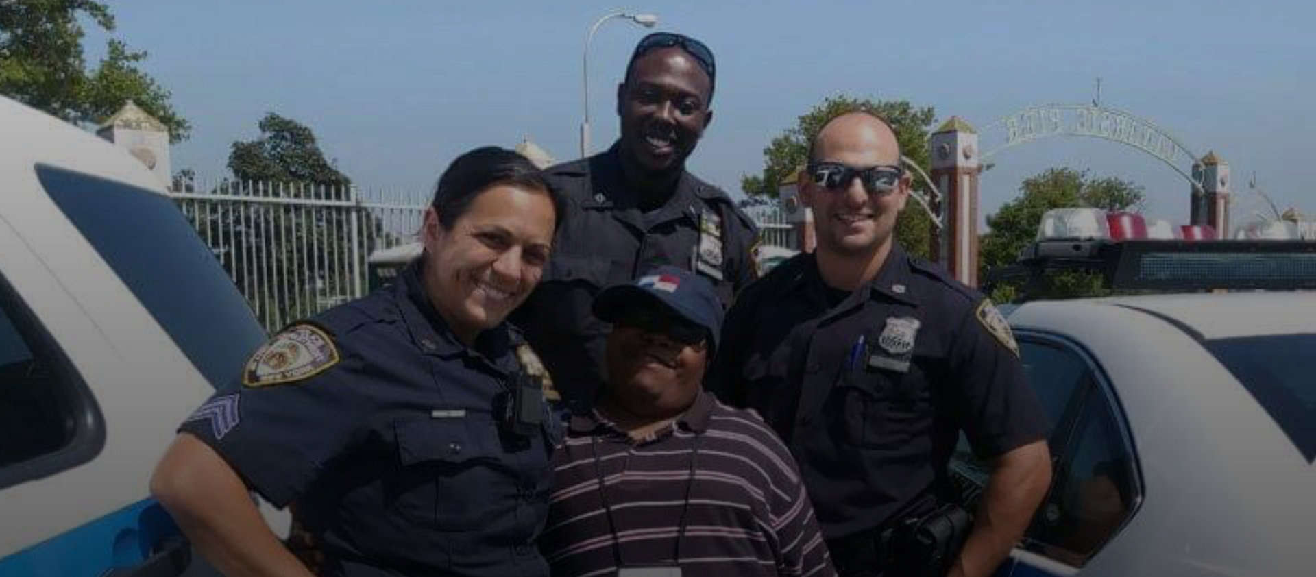 happy policemen and woman with a man